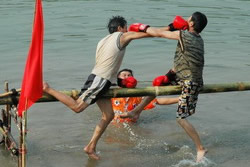 The one remaining on the pole wins in this traditional boxing game.